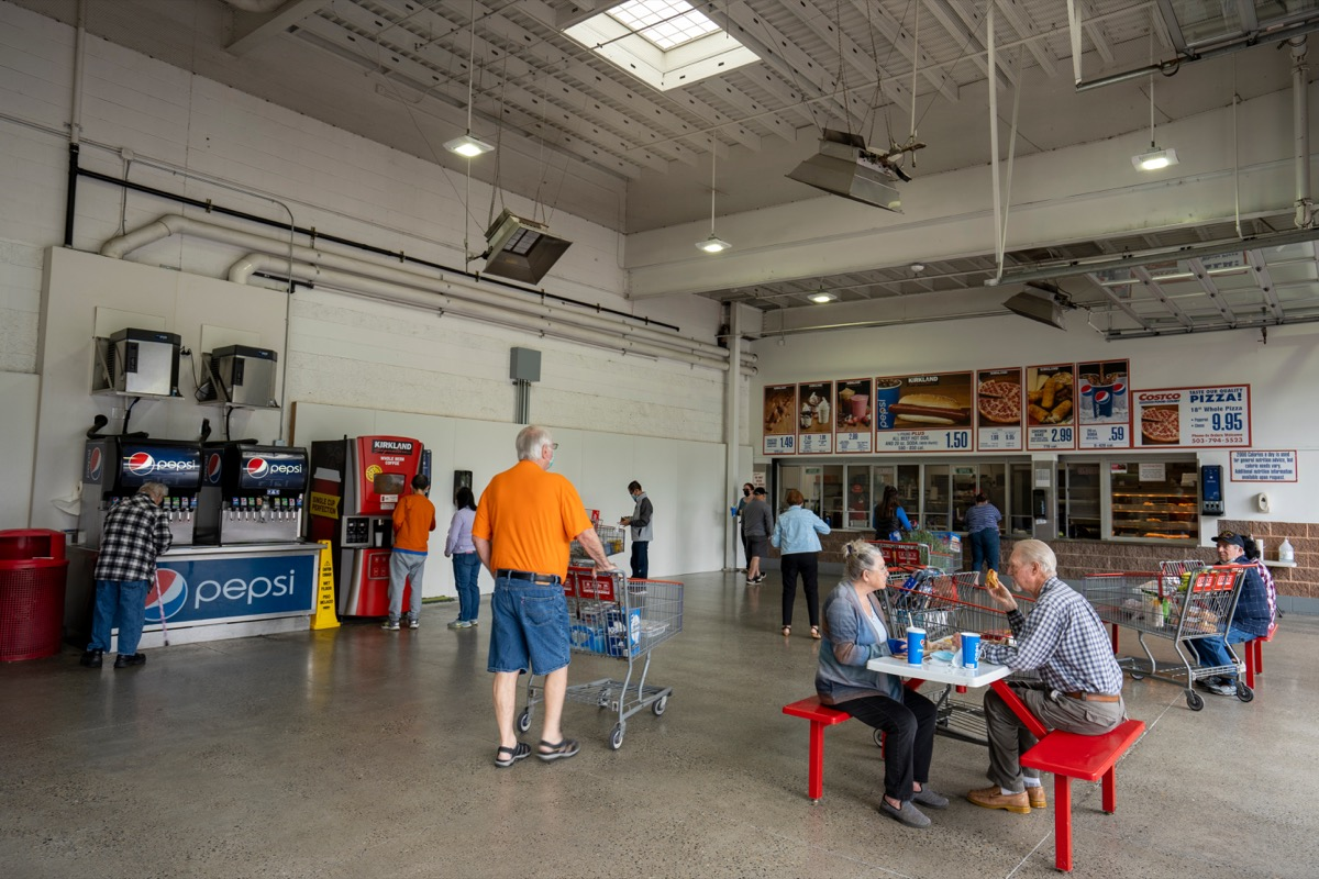 Clackamas, OR, USA - Jun 8, 2021: Shoppers enjoy their lunch in the distanced seating area at the Costco Store food court, as COVID cases continue to drop in Oregon.