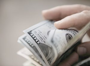 Unrecognizable mature man counting dollar bills
