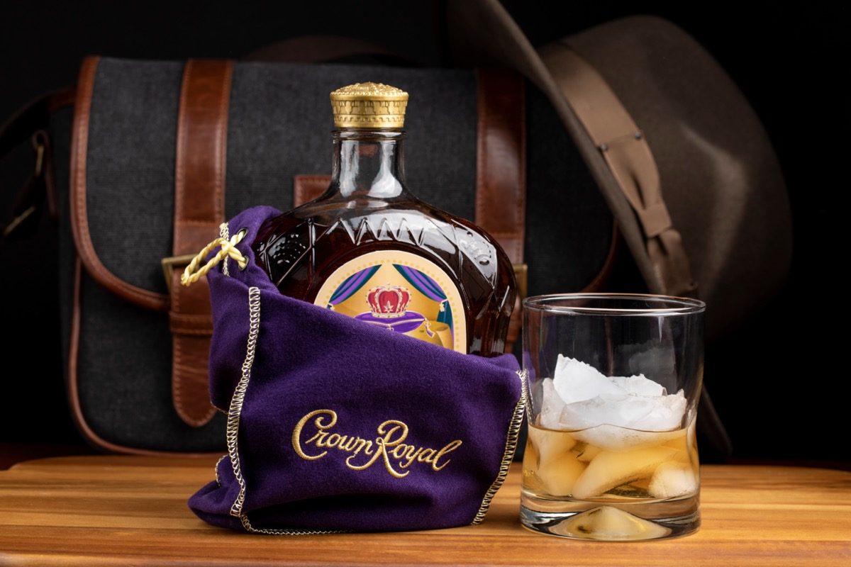 Crown Royal in a bag next to a glass of ice