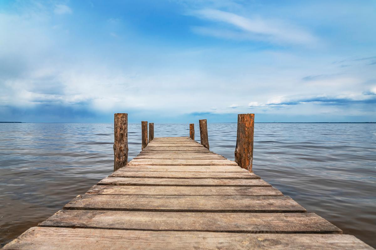 Perspective view of wooden pier on ocean
