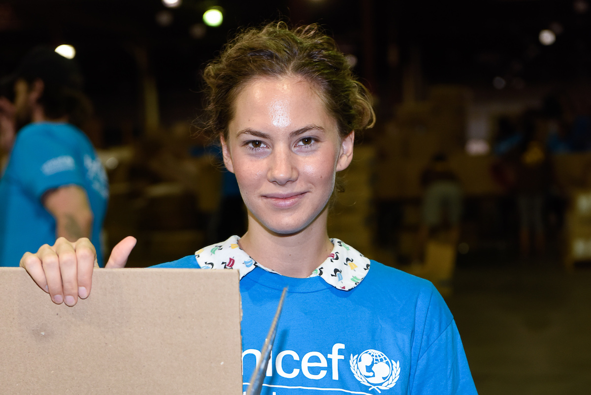 Emma Ferrer, Audrey Hepburn's Granddaughter, Joins UNICEF And UPS Volunteers In Packing Thousands Of Winter Survival Kits For Syrian Children on September 7, 2014 in Edison, New Jersey.