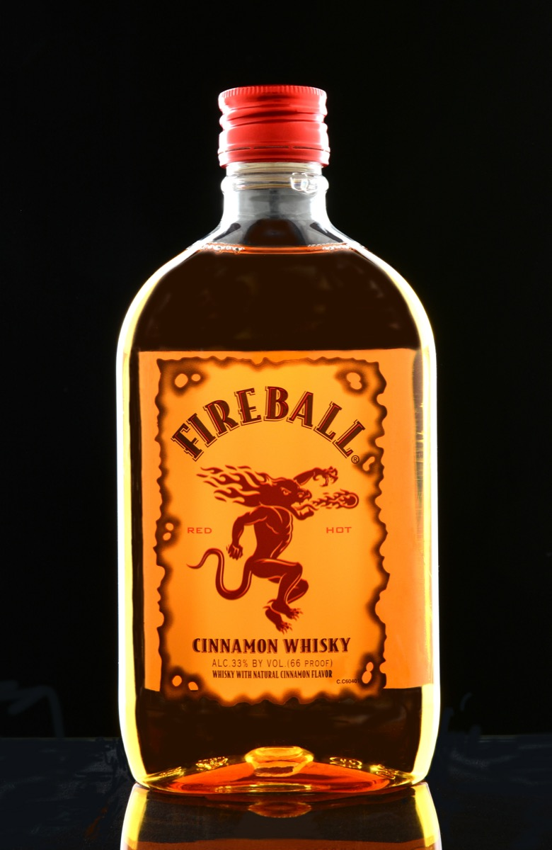 Bottle of fireball in front of a black background
