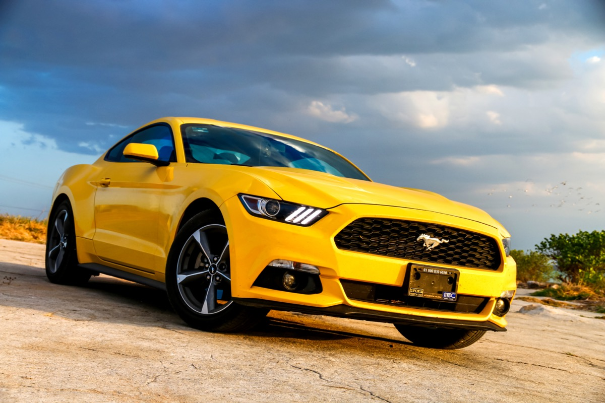 A yellow Ford Mustang