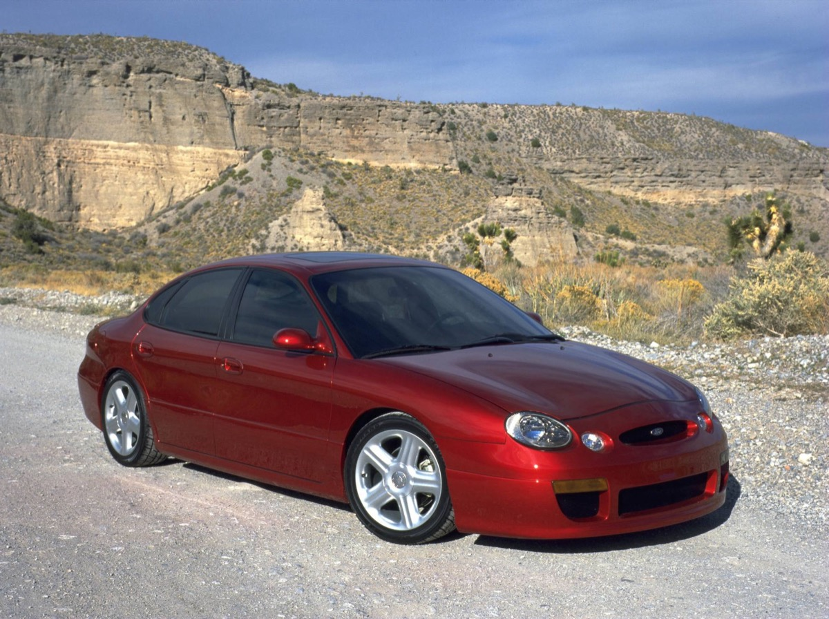 A red Ford Taurus