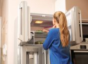 Woman looking in the freezer