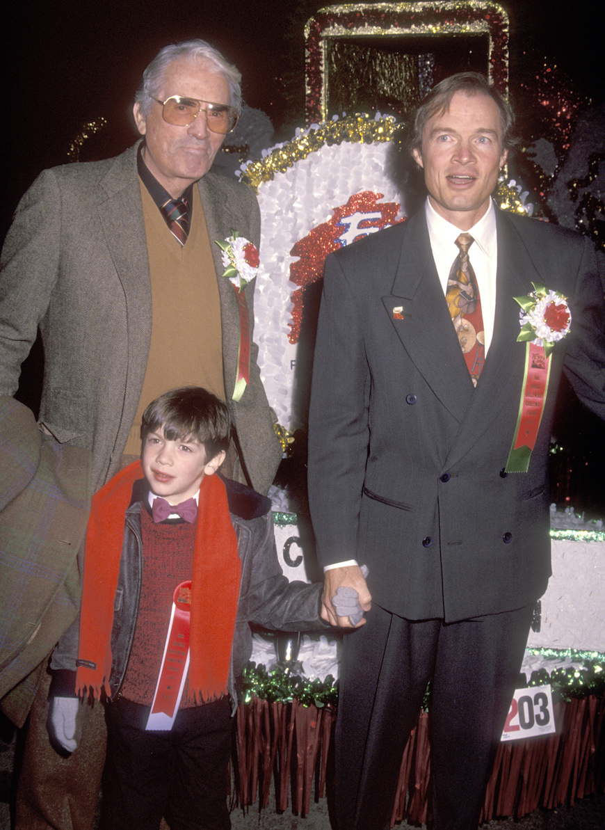 Actor Gregory Peck, son Stephen Peck and his son Ethan Peck attend the 60th Annual Hollywood Christmas Parade on December 1, 1991 at KTLA Studios in Hollywood, California.