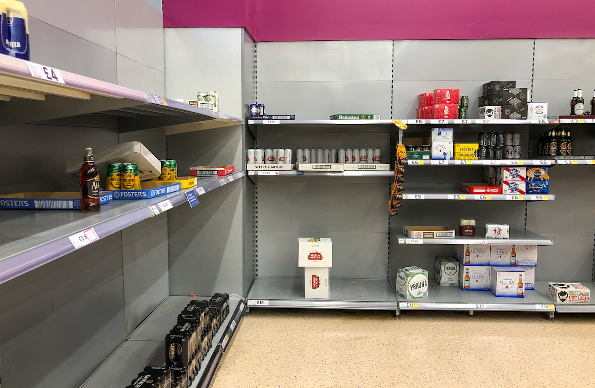 Empty shelves of beer and lager at a supermarket