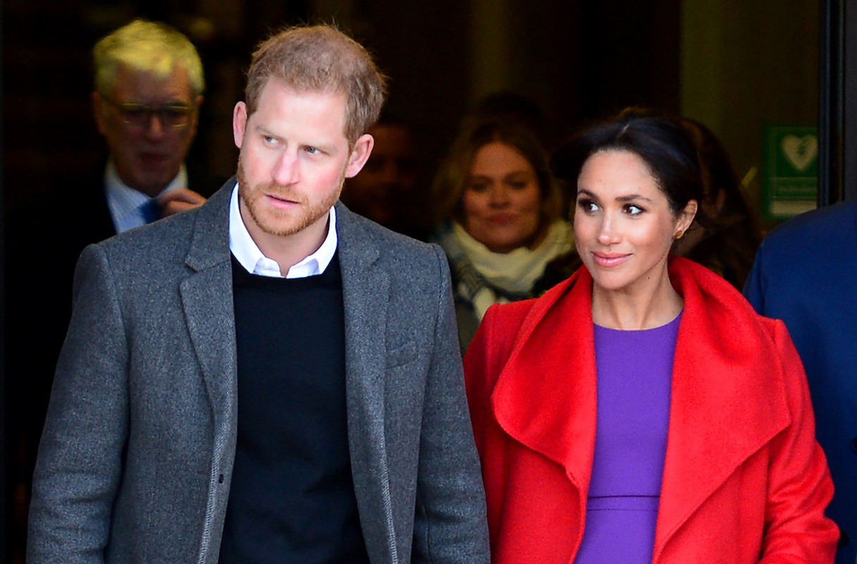Prince Harry, Duke of Sussex and Meghan, Duchess of Sussex depart from Birkenhead Town Hall on January 14, 2019 in Birkenhead, England.