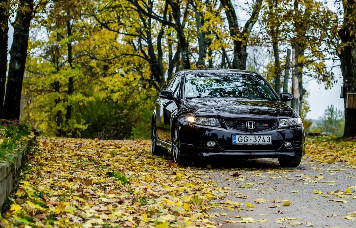 A black Honda Accord outside