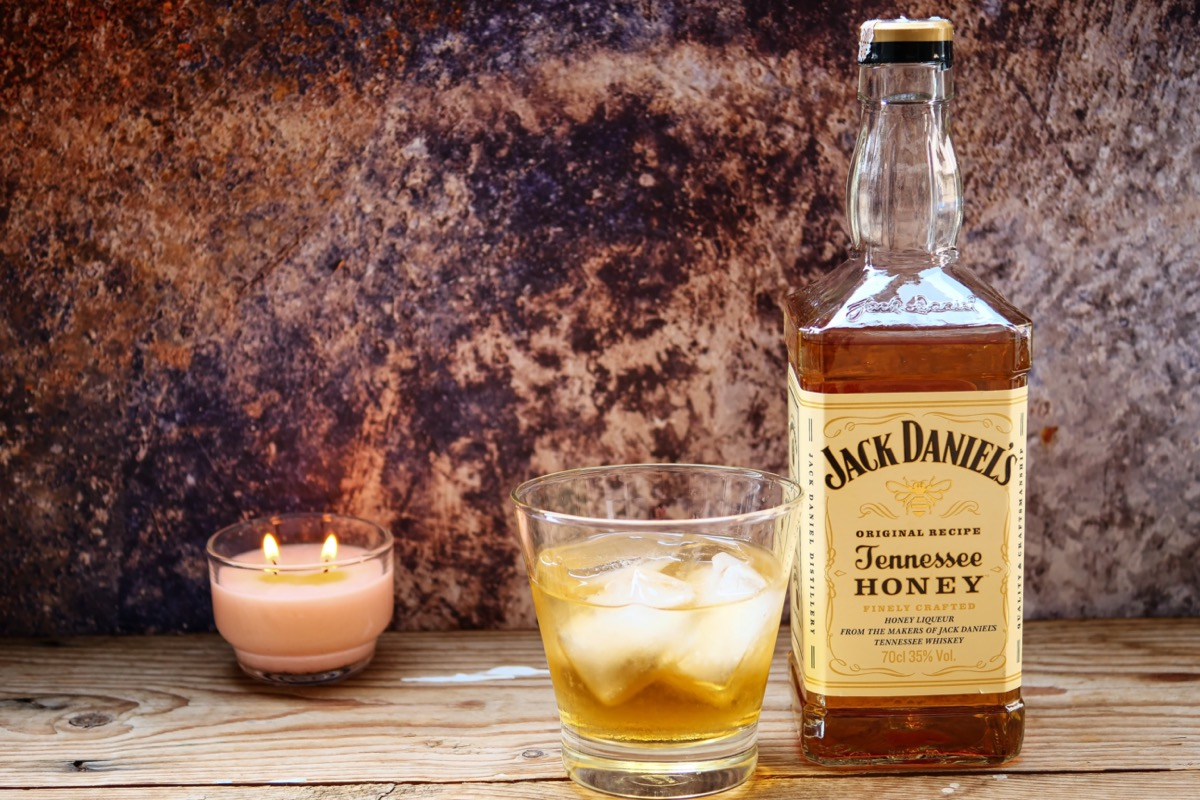 Jack Daniel's next to a glass and candle