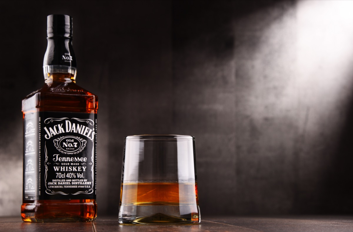 Jack Daniel's and glass in front of a grey background