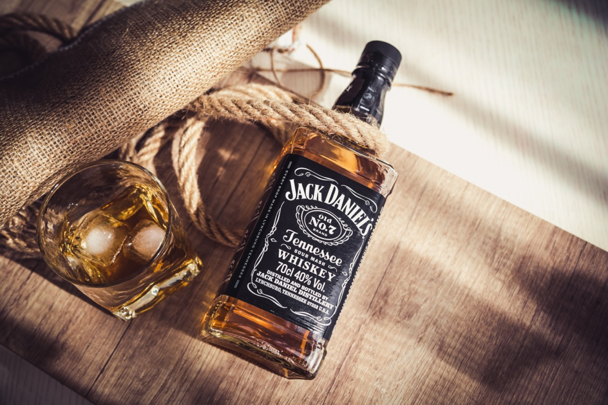 Jack Daniel's bottle and glass on cloth