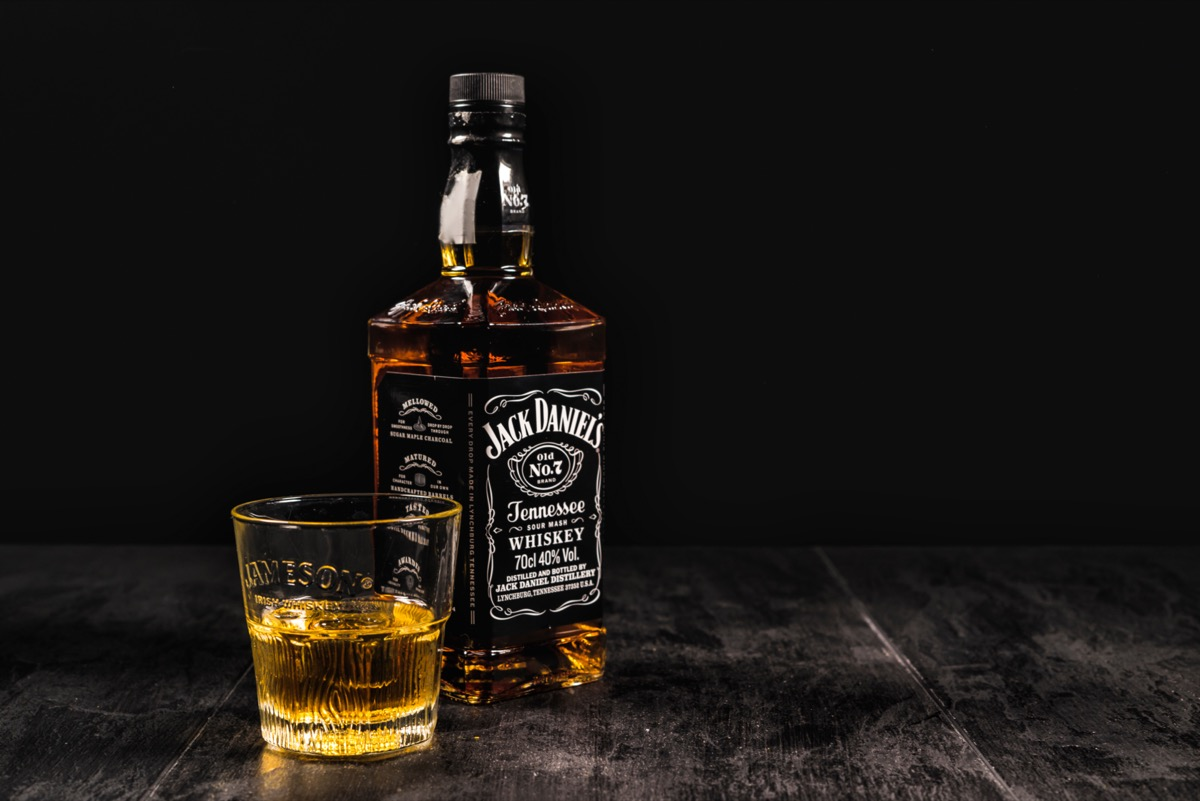 Jack Daniel's bottle and glass on a table