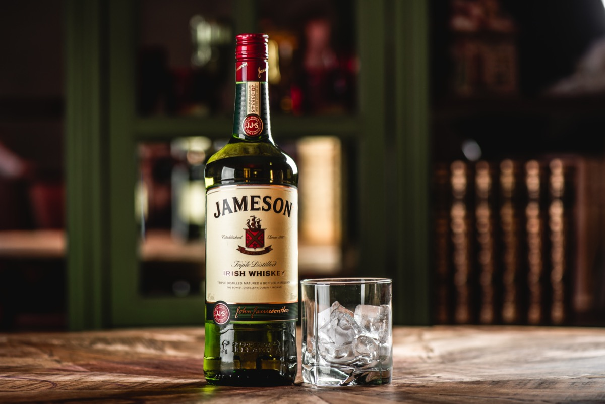 A bottle of Jameson next to a glass of ice