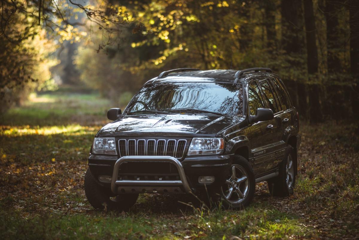 A black Jeep Grand Cherokee outside