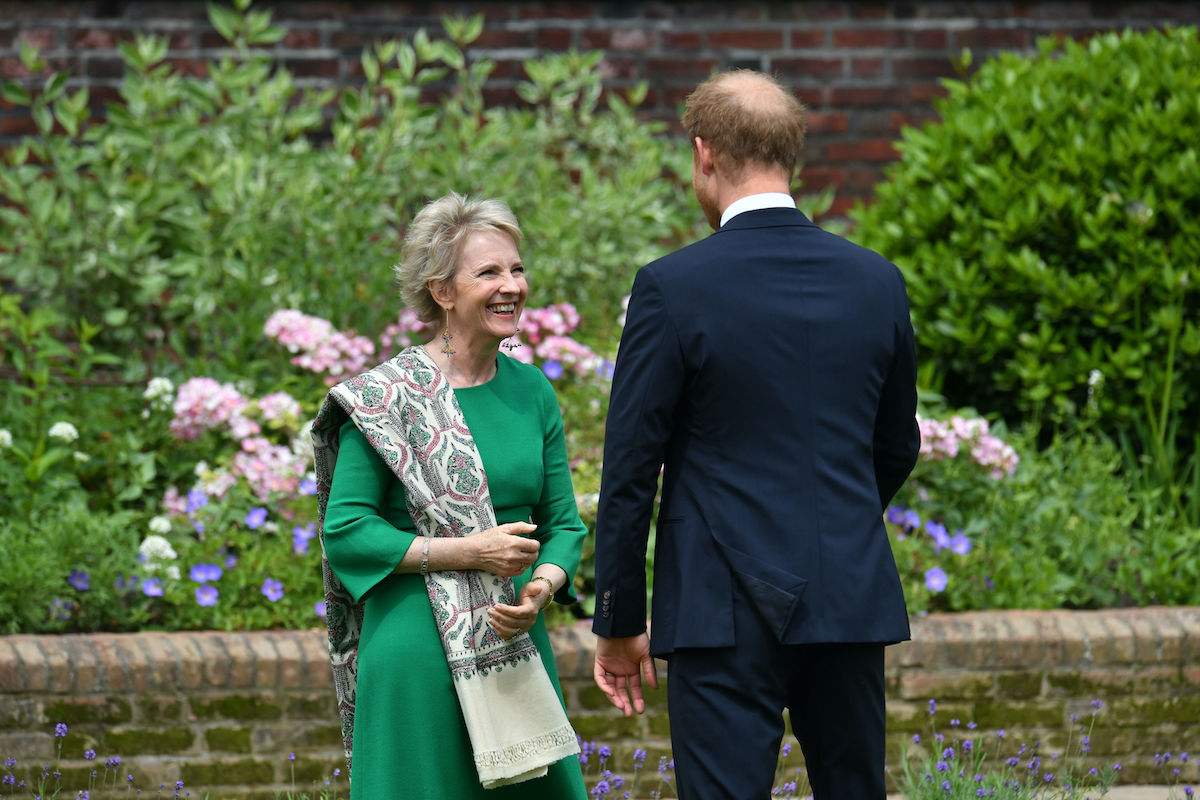 Prince Harry, Duke of Sussex greets Julia Samuel, founder of Child Bereavement UK during the unveiling of a statue of Diana, Princess of Wales, in the Sunken Garden at Kensington Palace