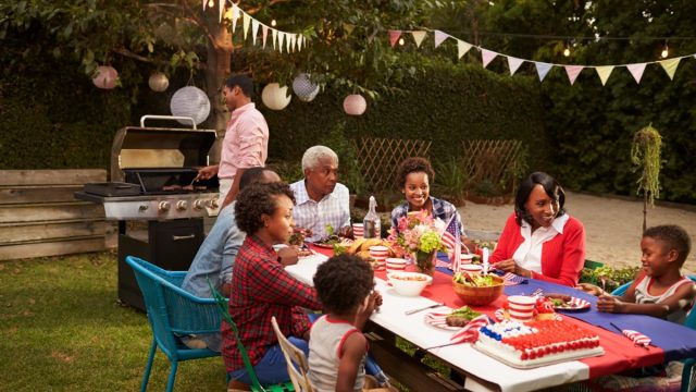 family having a july 4th barbecue in the backyard