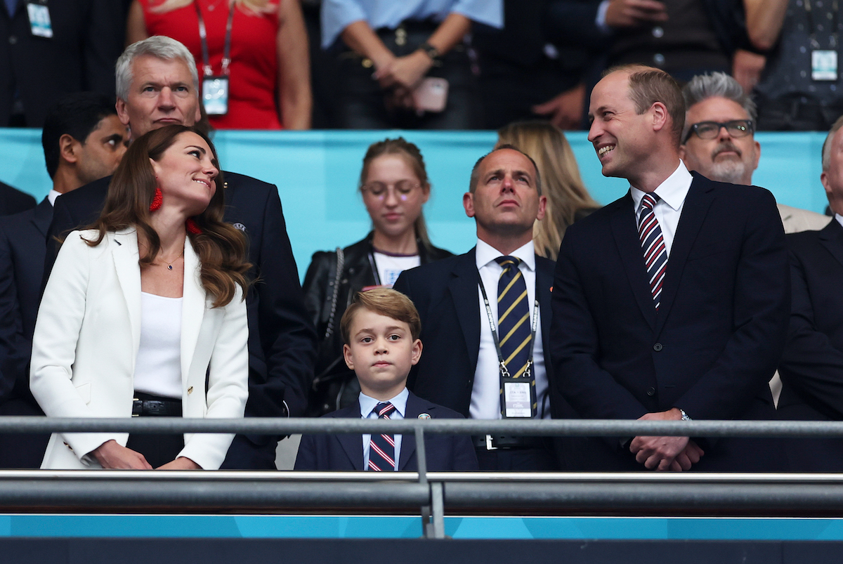 Catherine, Duchess of Cambridge, Prince George of Cambridge and Prince William, Duke of Cambridge and President of the Football Association look on during the UEFA Euro 2020 Championship Final between Italy and England at Wembley Stadium on July 11, 2021 in London, England.