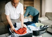 Senior couple packing a wardrobe for the trip