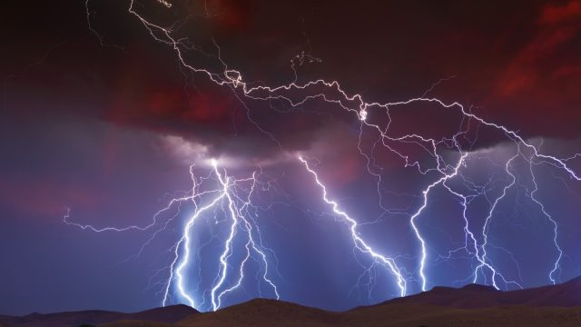 lightning striking hills