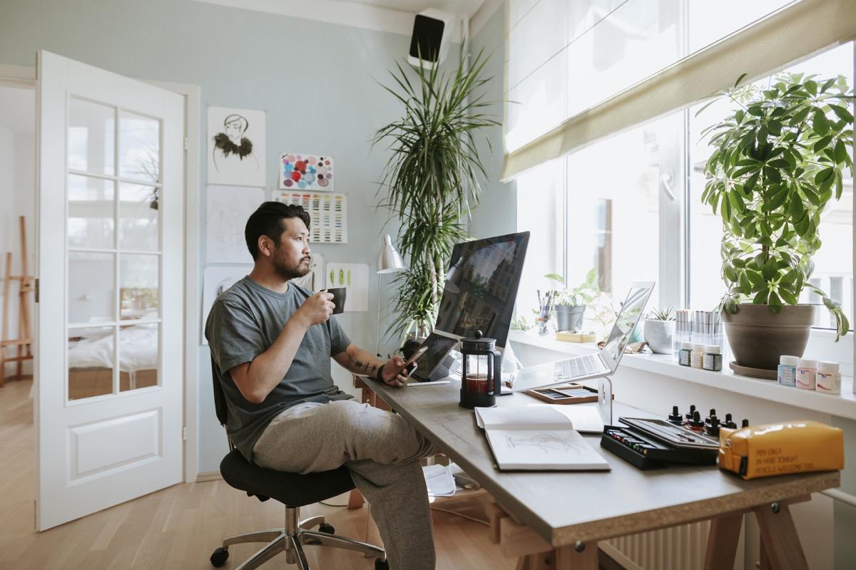 digital artist at his home studio taking a coffee break.