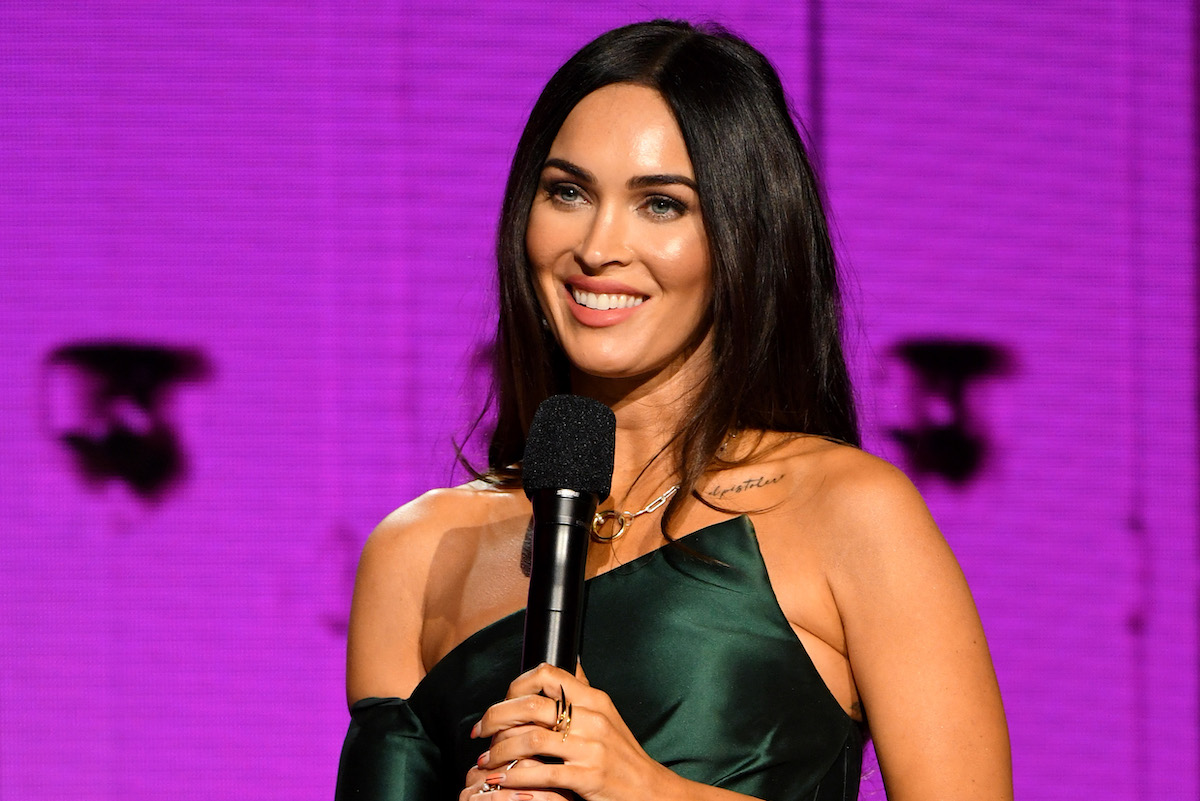 In this image released on November 22, Megan Fox speaks onstage for the 2020 American Music Awards at Microsoft Theater on November 22, 2020 in Los Angeles, California.