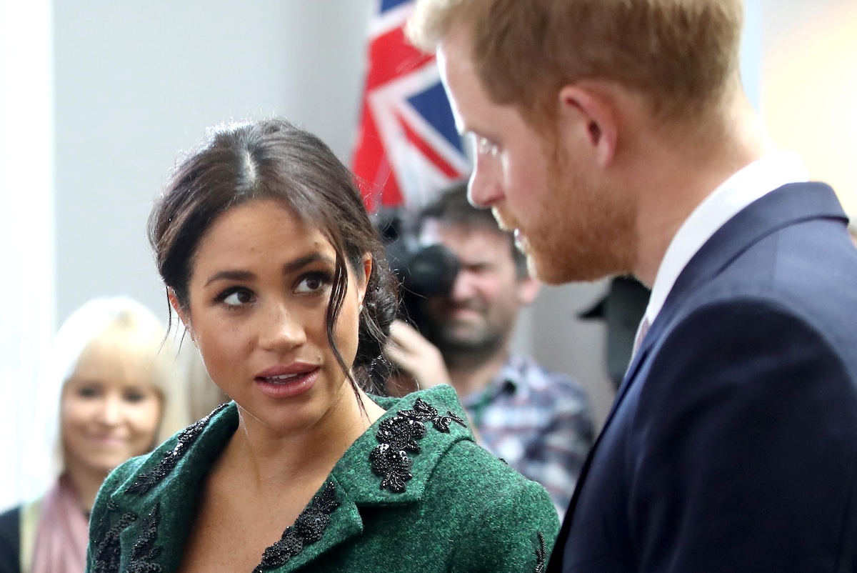 Meghan, Duchess of Sussex (L) and Britain's Prince Harry, Duke of Sussex,