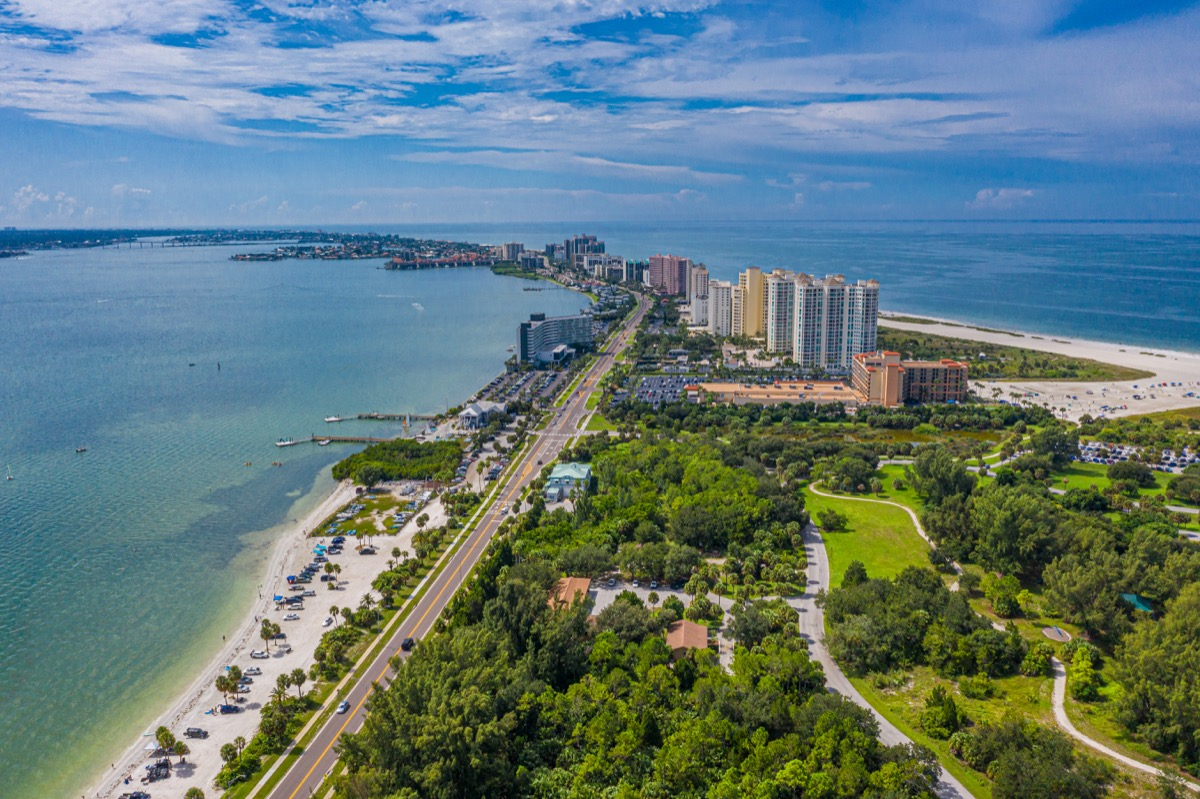 Aerial drone photo of beach and condos near St. Petersburg and Clearwater Beach, Florida.