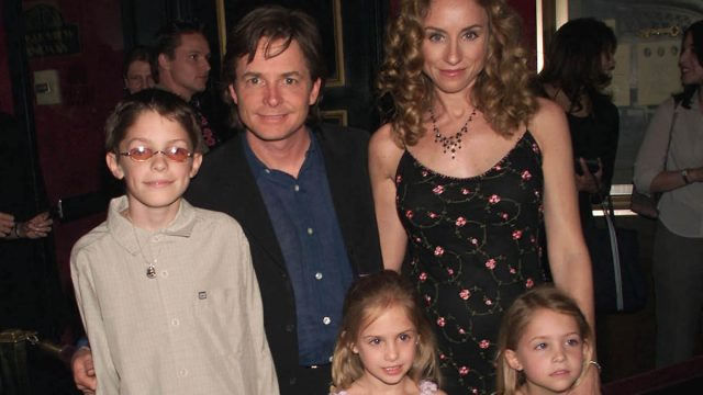 Actor Michael J. Fox arrives with his family, wife Tracy, son Sam, and twin daughters Schuyler and Aquinnah, at the New York premiere of the new Disney film 'Atlantis: The Lost Empire,' at the Ziegfeld Theater in New York City. June 6, 2001.