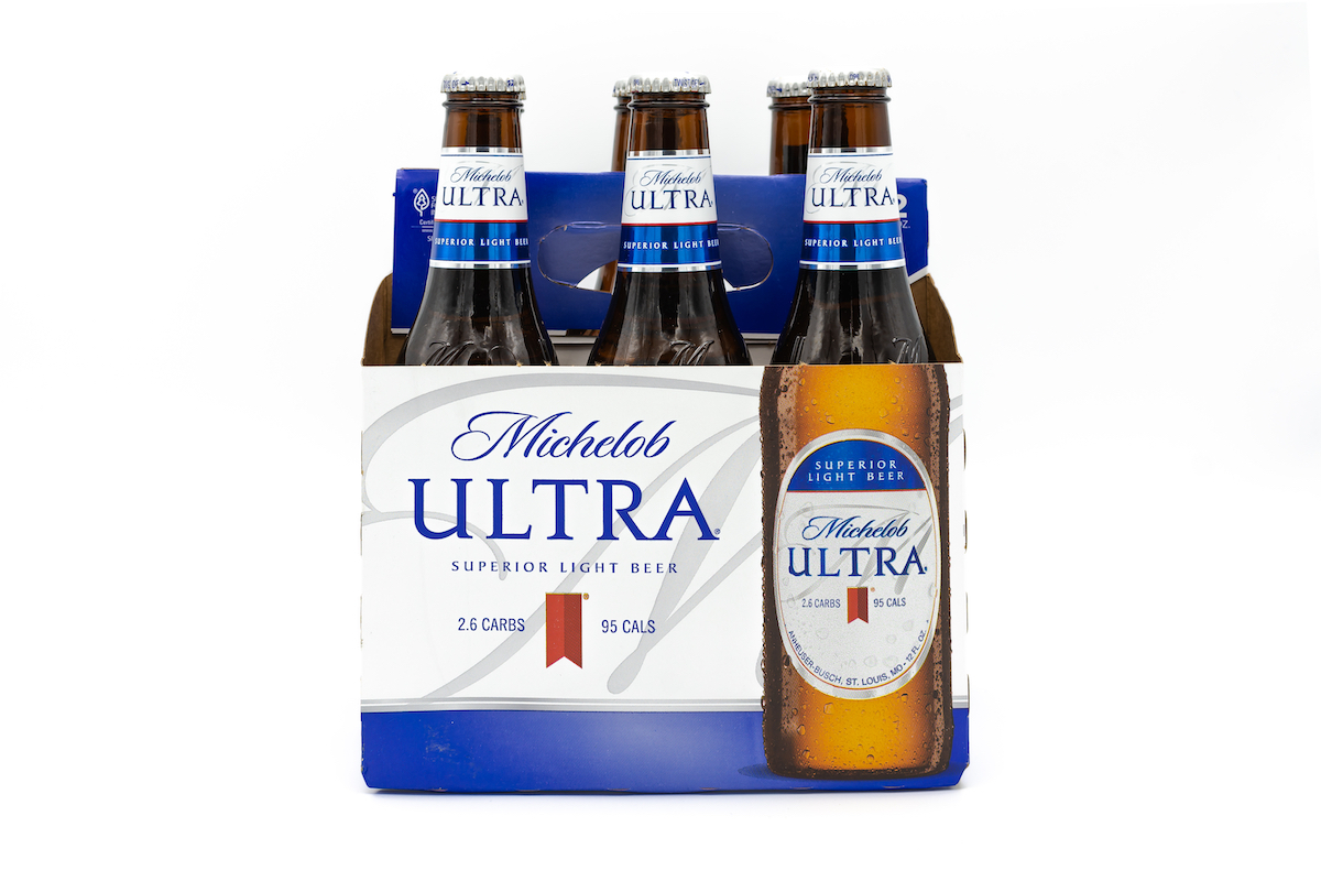 Pack of Michelob ULTRA Superior Light Beer on white background.