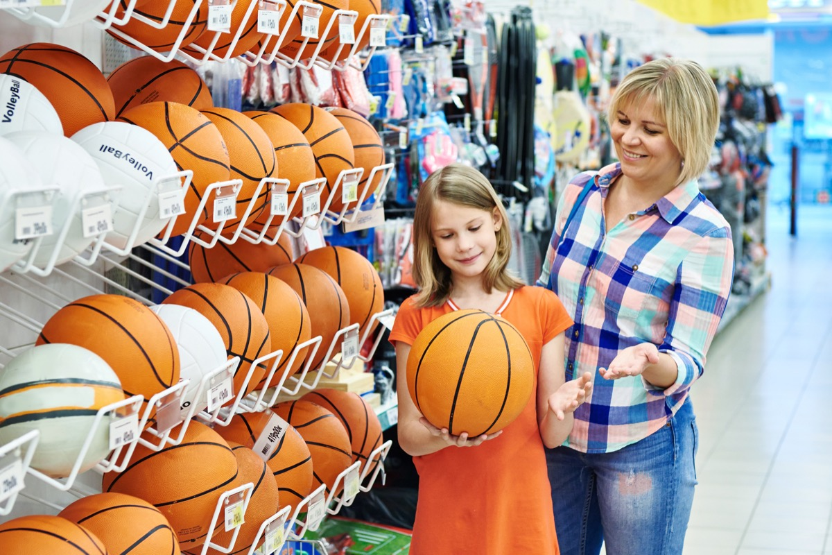 mom buying basketball for daughter