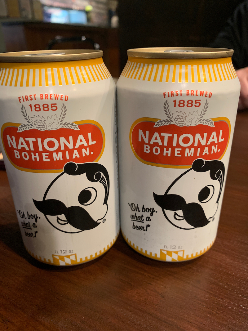 Two unopened ice cold cans of Natty Boh aka National Bohemian