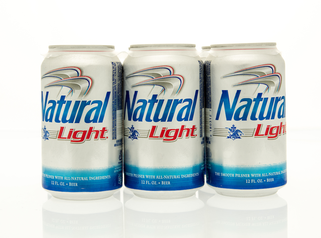 A six pack of Natural Light beer in cans.