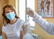 Doctor giving a senior woman a vaccination. Virus protection.