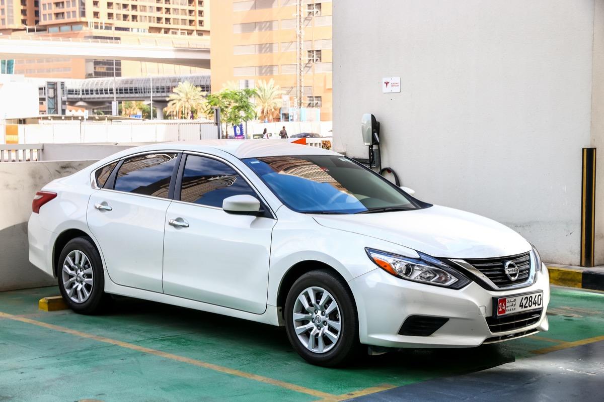 A white Nissan Altima