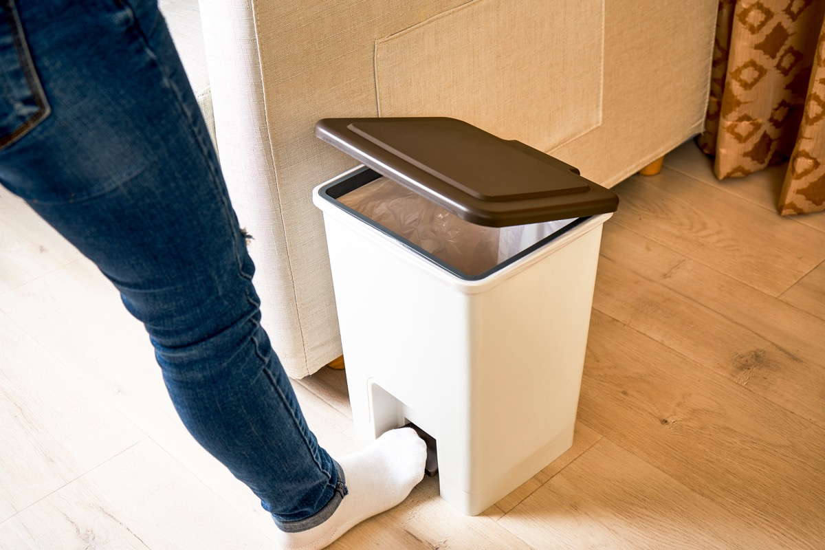 stepping on trash can pedal to open it