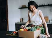 woman received a full box of colourful and fresh organic groceries