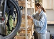 woman looking through stuff she's left in garage