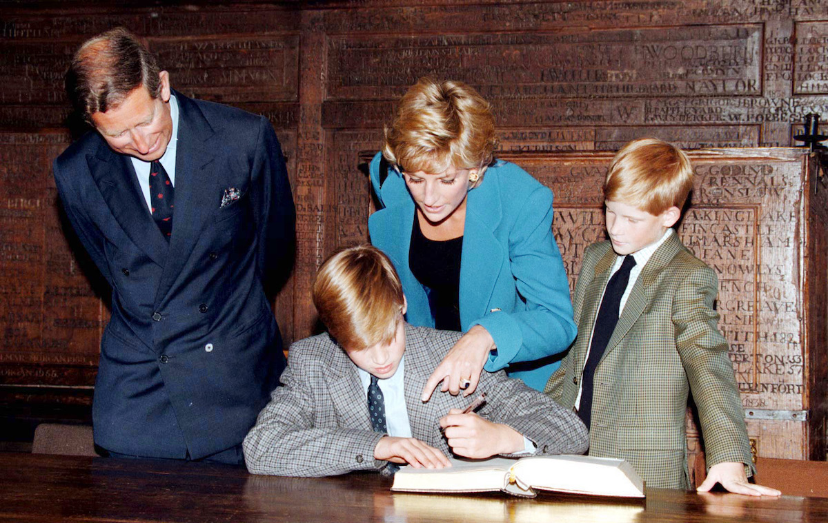 Prince William signs in on his first day at Eton College watched by his parents, he Prince and Princess of Wales and brother, Prince Harry on September 06, 1995 in Windsor, England.
