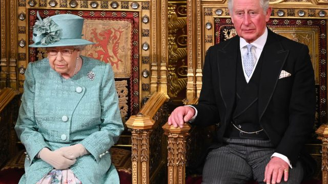 Queen Elizabeth II and Prince Charles, Prince of Wales attend the State Opening of Parliament in the House of Lord's Chamber on December 19, 2019 in London, England.