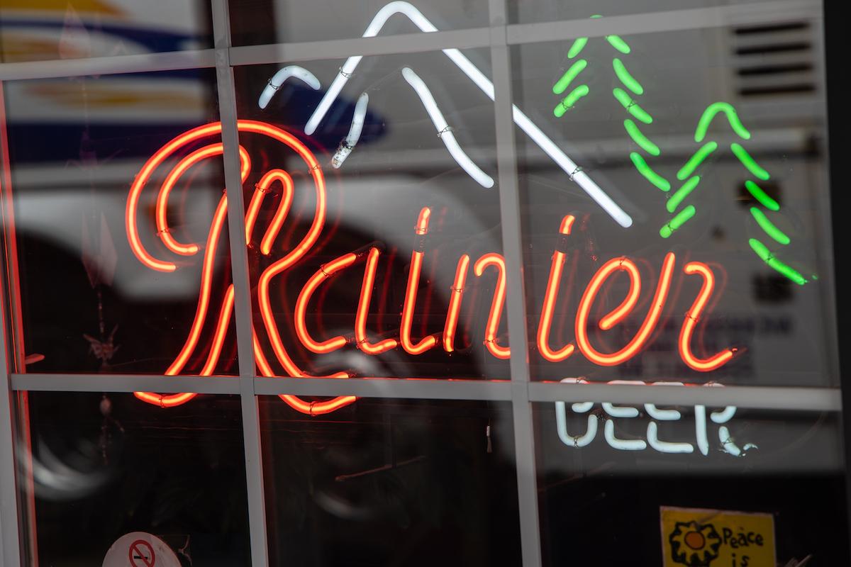 Bright neon Rainier Beer sign in the window of a local pub in Glacier, WA