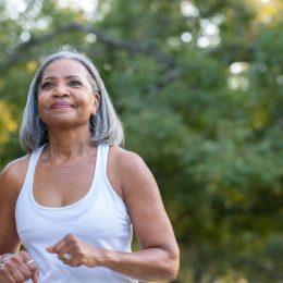Senior woman walking in public park