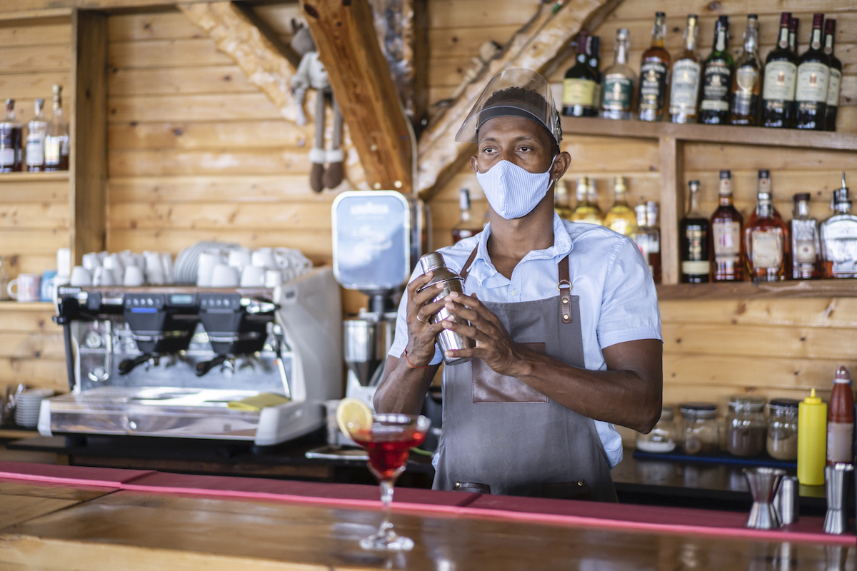 Disappointed bartender waiting for customers in times after coronavirus pandemic