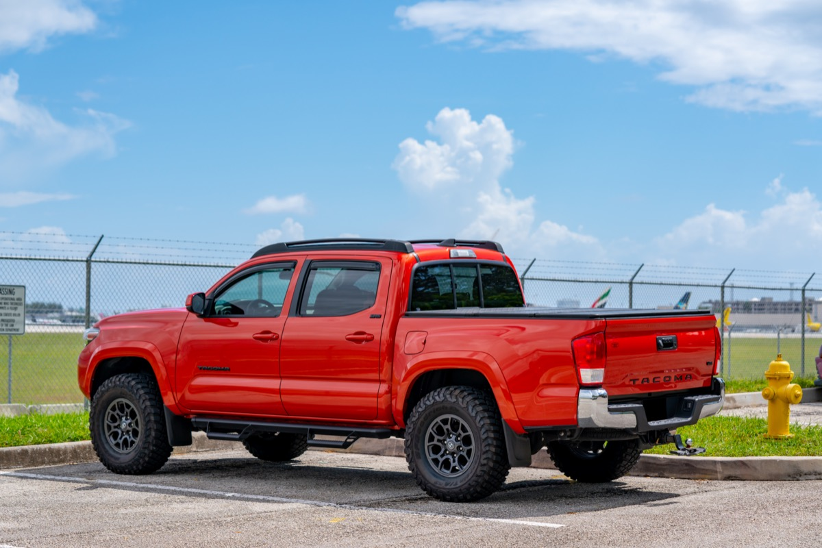 A red Toyota Tacoma pickup