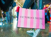 MOSCOW, RUSSIA - CIRCA AUGUST, 2018: a woman stand with Victoria's secret branded shopping bag in Vnukovo International Airport