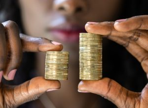 Woman holding coins to show wage gap