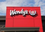 SPENCER , WISCONSIN, October, 16, 2015 Wendy's Restaurant Sign on a Storefront Wendy's is an international food chain of stores and was founded in 1969