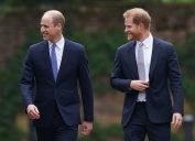 Britain's Prince William, Duke of Cambridge, (L) and Britain's Prince Harry, Duke of Sussex, arrive for the unveiling of a statue of their mother, Princess Diana at The Sunken Garden in Kensington Palace, London on July 1, 2021.