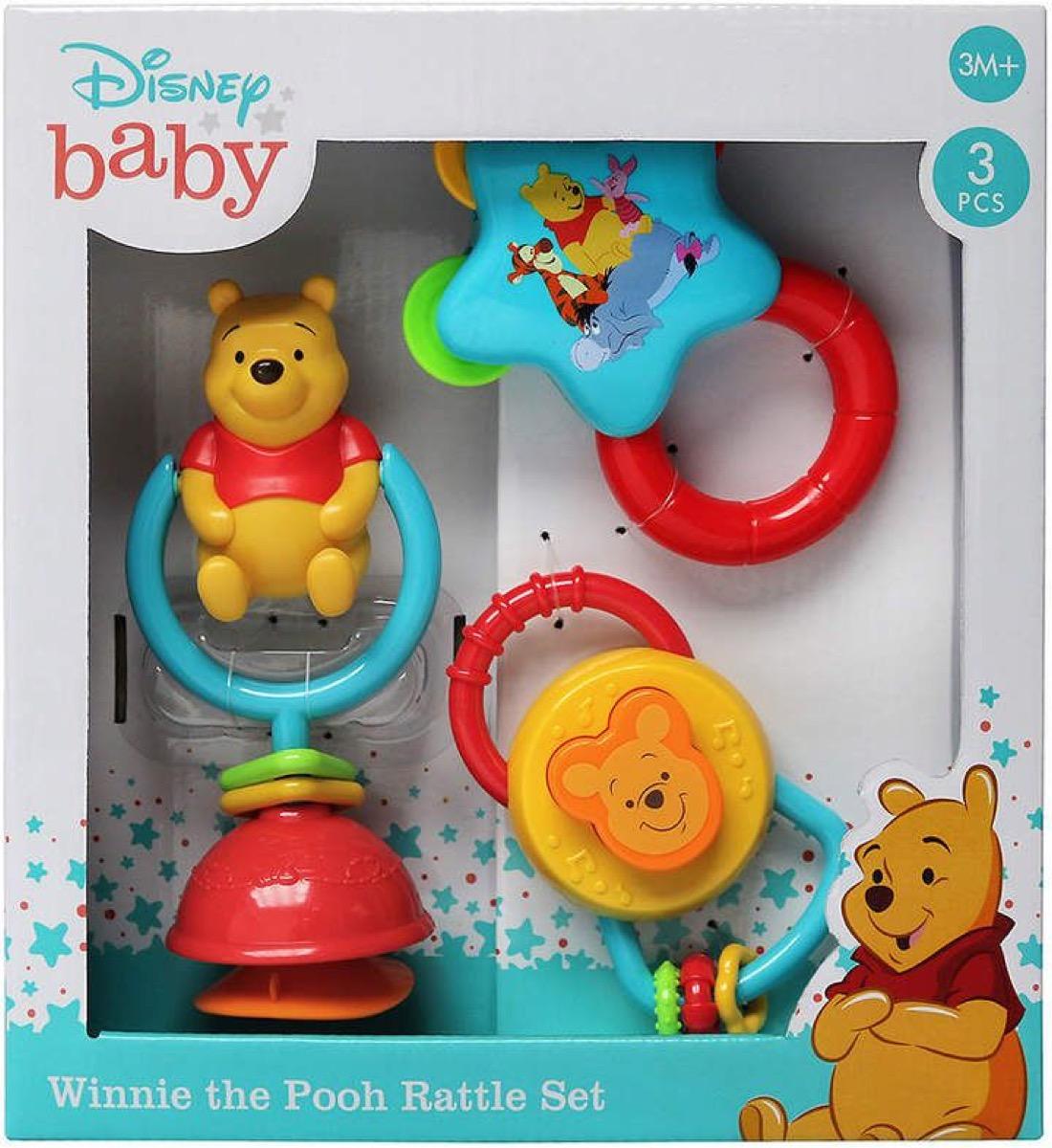 three winnie the pooh rattles in cardboard box