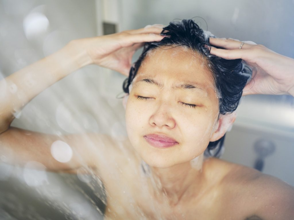 woman relaxing in a warm shower.